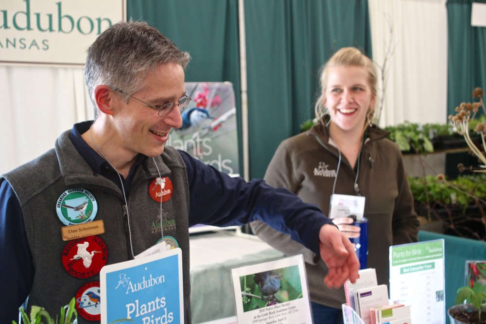 Dan Scheiman (left) and Uta Meyer talk up Audubon Arkansas in the Hall of Industry on March 3 during the 2018 Arkansas Flower and Garden Show on the Arkansas State Fairgrounds. Photo by Celia Storey