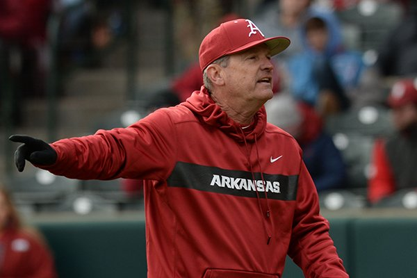 Arkansas coach Dave Van Horn speaks to his staff against Eastern Illinois Saturday, Feb. 16, 2019, during the seventh inning at Baum-Walker Stadium in Fayetteville. Visit nwadg.com/photos to see more photographs from the games.