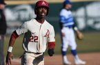 Arkansas freshman Curtis Washington Jr. runs toward home plate to score the winning run against Eastern Illinois on Sunday, Feb. 17, 2019, in Fayetteville.
