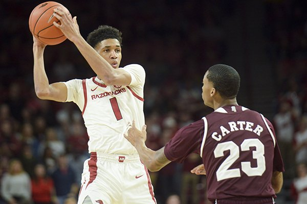 Arkansas guard Isaiah Joe looks to pass during a game against Mississippi State on Saturday, Feb. 16, 2019, in Fayetteville.
