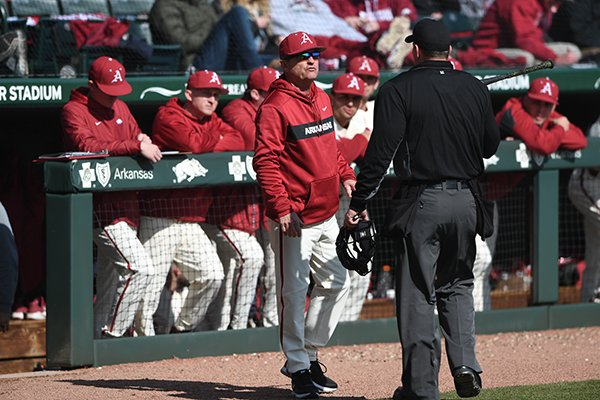 Arkansas coach Dave Van Horn talks to home plate umpire Mark Wagers during a game against Eastern Illinois on Sunday, Feb. 17, 2019, in Fayetteville.