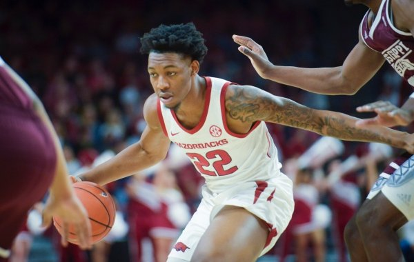 Arkansas Razorbacks forward Gabe Osabuohien (22) carries the ball during a basketball game, Saturday, February 16, 2019 at Bud Walton Arena in Fayetteville.