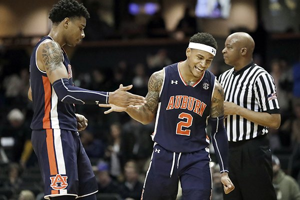 Auburn forward Chuma Okeke, left, and guard Bryce Brown (2) celebrate after Auburn beat Vanderbilt 64-53 in an NCAA college basketball game Saturday, Feb. 16, 2019, in Nashville, Tenn. (AP Photo/Mark Humphrey)