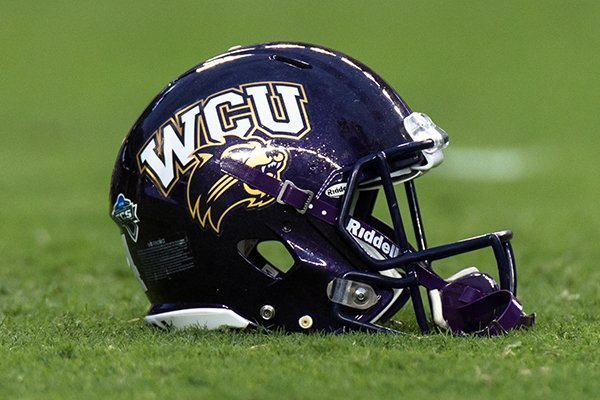 Western Carolina's helmet on the field before the start of an NCAA college football game between Texas A&M and Western Carolina Saturday, Nov. 14, 2015, in College Station, Texas. (AP Photo/Juan DeLeon)
