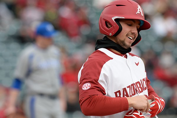 Arkansas center fielder Dominic Fletcher takes off his batting gloves after making an out against Eastern Illinois Saturday, Feb. 16, 2019, at Baum-Walker Stadium in Fayetteville.