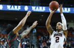 Auburn guard Bryce Brown (2) sinks a three-point shot over Arkansas guard Desi Sills (0)during the second half of an NCAA college basketball game Wednesday, Feb. 20, 2019, in Auburn, Ala. (AP Photo/Julie Bennett)