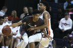 Auburn forward Chuma Okeke, right, pressures Arkansas guard Isaiah Joe, left, during the first half of an NCAA college basketball game Wednesday, Feb. 20, 2019, in Auburn, Ala. (AP Photo/Julie Bennett)