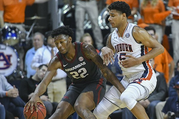 Arkansas forward Gabe Osabuohien (22) pushes past Auburn forward Chuma Okeke (5) during the second half of an NCAA college basketball game Wednesday, Feb. 20, 2019, in Auburn, Ala. (AP Photo/Julie Bennett)
