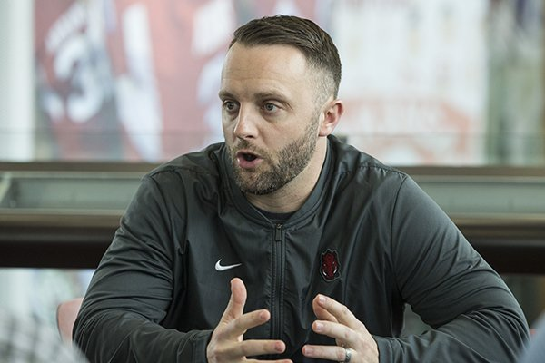 Arkansas offensive coordinator Joe Craddock speaks to the media on Thursday, Feb. 21, 2019, at Fred W. Smith Center in Fayetteville.