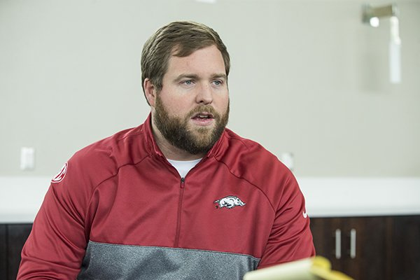 Arkansas offensive line coach Dustin Fry speaks to reporters Thursday, Feb. 21, 2019, at Fred W. Smith Center in Fayetteville.
