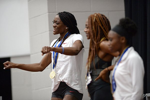 Arkansas' Kelsey Herman (left) celebrates Friday, Feb. 22, 2019, after winning the pentathlon during the Southeastern Conference Indoor Track and Field Championship at the Randal Tyson Track Center in Fayetteville.