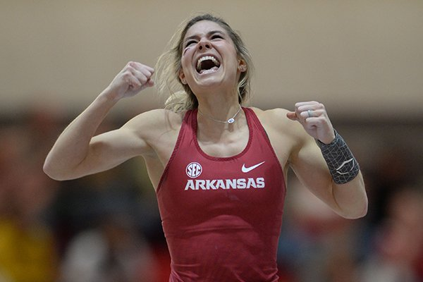 Arkansas' Lexi Jacobus celebrates clearing a height Saturday, Feb. 23, 2019, as she competes in the pole vault during the Southeastern Conference Indoor Track and Field Championship at the Randal Tyson Track Center in Fayetteville.