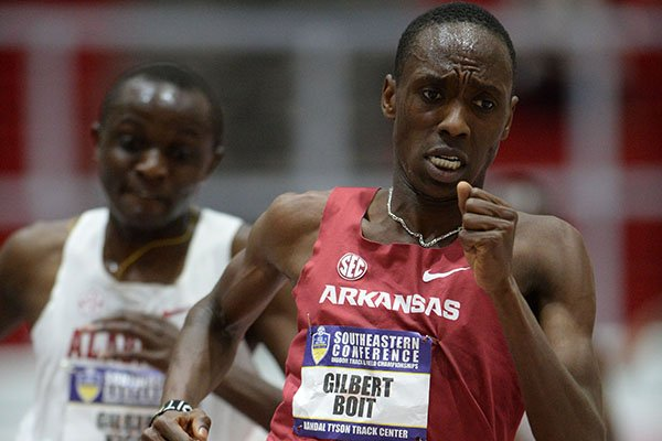 Arkansas' Gilbert Boit (right) pulls ahead of Alabama's Gilbert Kigen Friday, Feb. 22, 2019, in the final lap of the 5,000 meters during the Southeastern Conference Indoor Track and Field Championship at the Randal Tyson Track Center in Fayetteville.