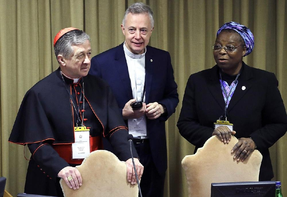"""Sister Veronica Openibo, a prominent Nigerian nun, talks with Chicago Archbishop and Cardinal Blase J. Cupich (left) and the Rev. Tomas Mavric at the Vatican on Saturday. Openibo spoke out against the culture of silence that has covered up clergy sexual abuse for so long. """"How could the clerical church have kept silent, covering these atrocities?"""" she asked."""