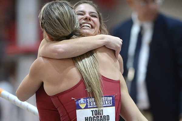 Arkansas' Lexi Jacobus (right) and her twin sister Tori Hoggard hug Saturday, Feb. 23, 2019, as they compete in the pole vault during the Southeastern Conference Indoor Track and Field Championship at the Randal Tyson Track Center in Fayetteville.
