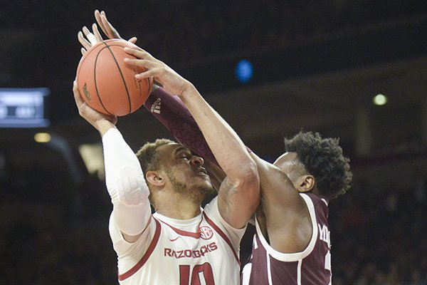 Arkansas forward Daniel Gafford goes up for a shot during a game against Texas A&M on Saturday, Feb. 23, 2019, in Fayetteville.