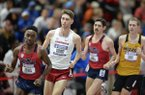 Arkansas' Cameron Griffith (center) trails Ole Miss' Waleed Suliman as he competes Saturday, Feb. 23, 2019, in the mile during the Southeastern Conference Indoor Track and Field Championship at the Randal Tyson Track Center in Fayetteville.