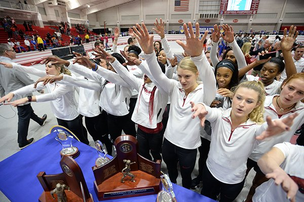 Members of the Arkansas women's indoor track and field team celebrates Saturday, Feb. 23, 2019, after winning the Southeastern Conference Indoor Track and Field Championship at the Randal Tyson Track Center in Fayetteville.