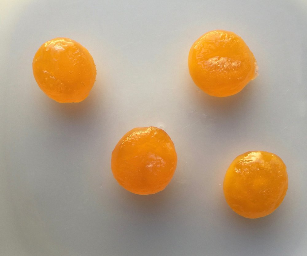 After spending several days curing in a mixture of salt and sugar, the egg yolks are rinsed clean and patted dry. 