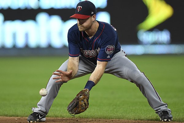 Minnesota Twins second baseman Logan Forsythe makes a play on a ground ball to throw out Kansas City Royal Rosell Herrera at first base during the fifth inning of a baseball game in Kansas City, Mo., Saturday, Sept. 15, 2018. (AP Photo/Reed Hoffmann)