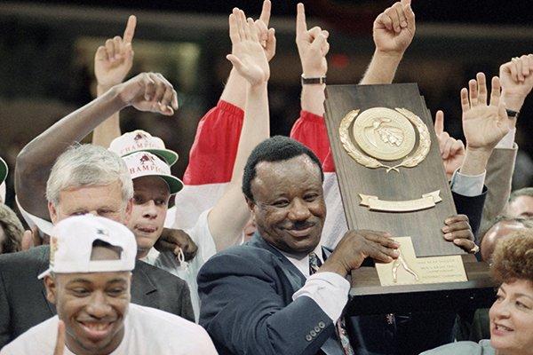 Arkansas coach Nolan Richardson shows off the NCAA National Championship trophy after the Razorbacks beat Duke 76-72, Monday, April 4, 1994, in Charlotte, N.C. (AP Photo/Ed Reinke)