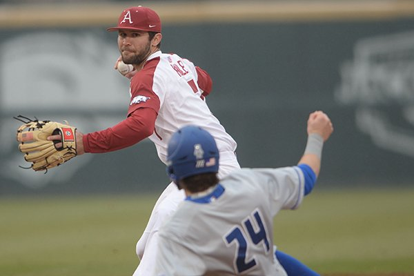 Arkansas second baseman Jack Kenley (top) prepares to make the relay to first after forcing out Memphis second baseman Ben Brooks Wednesday, Feb. 27, 2019, during the first inning at Baum-Walker Stadium in Fayetteville.