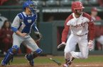 Arkansas second baseman Jack Kenley heads to first after hitting a two-run single against Memphis Wednesday, Feb. 27, 2019, during the Razorbacks' seven-run fifth inning at Baum-Walker Stadium in Fayetteville.