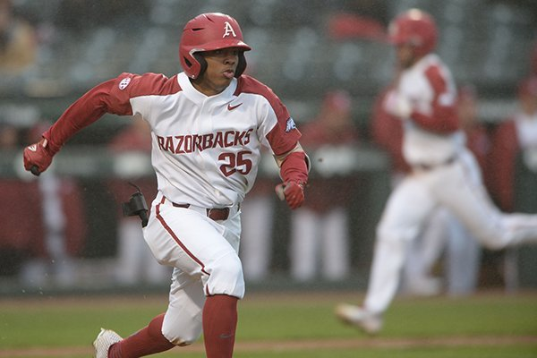 Arkansas left fielder Christian Franklin runs toward first base during a game against Memphis on Wednesday, Feb. 27, 2019, in Fayetteville.