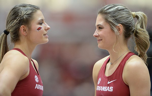 Arkansas pole vaulters Tori Hoggard (left) and Lexi Jacobus talk during the Southeastern Conference Indoor Track and Field Championships on Saturday, Feb. 23, 2019, in Fayetteville.