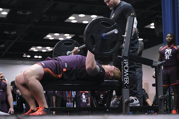 Arkansas offensive lineman Hjalte Froholdt does he bench press at the NFL football scouting combine in Indianapolis, Thursday, Feb. 28, 2019. (AP Photo/AJ Mast)