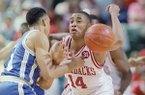 Arkansas guard Corey Beck (14) and Tulsa guard Shea Seals (21) battle for a loose ball in the NCAA Midwest Regional tournament on Friday, March 25, 1994 in Dallas. (AP Photo/David Longstreath)