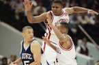 Duke's Jeff Capel (5) looks to pass around the defense of Arkansas' Corey Beck, right, and Dwight Stewart during the first half of the NCAA Final Four Championship Game in Charlotte, N.C., on Monday, April 4, 1994. (AP Photo/Ed Reinke)