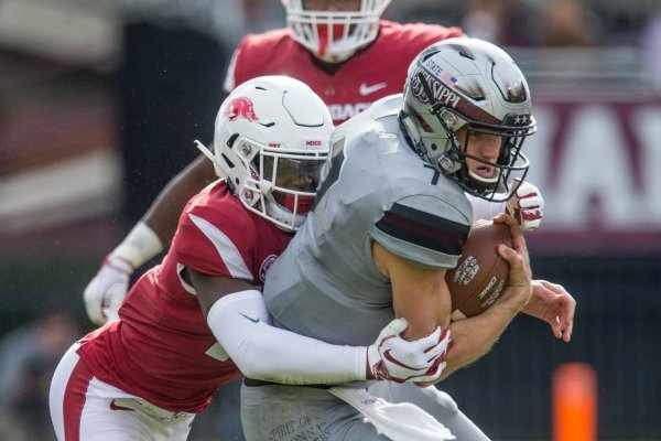 Joe Foucha, Arkansas free safety, tackles Nick Fitzgerald, Mississippi State quarterback, on a run in the third quarter Saturday, Nov. 17, 2018, at Davis Wade Stadium in Starkville, Miss.