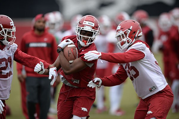 Arkansas receiver Shamar Nash runs after a catch during practice Friday, March 1, 2019, in Fayetteville.