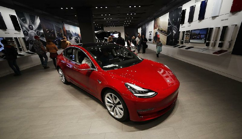 Tesla to sell Model 3s online, cut prices, Musk says