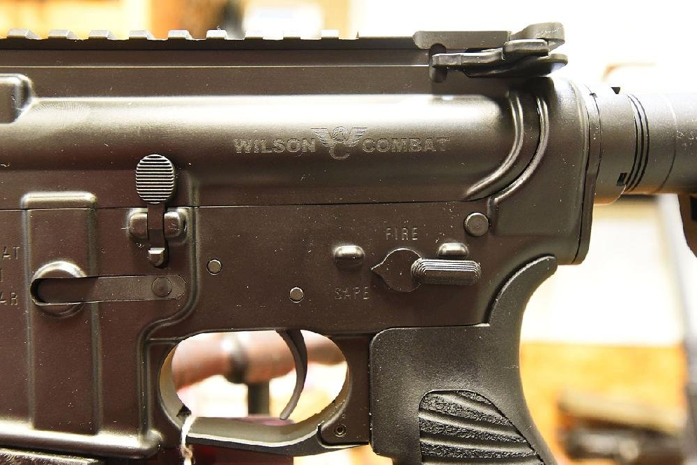 The Wilson Combat logo appears above the safety switch on a Protector Series rifle.