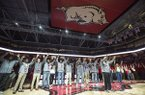 Members of Arkansas' 1994 national championship basketball team are recognized during a ceremony on Saturday, March 2, 2019, in Fayetteville.