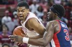 Arkansas guard Mason Jones drives against Ole Miss guard Terence Davis during a game Saturday, March 2, 2019, in Fayetteville.