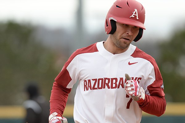 Arkansas infielder Jack Kenley runs the bases after hitting a home run during a game against Eastern Illinois on Saturday, Feb. 16, 2019, in Fayetteville.