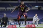 Arkansas defensive lineman Armon Watts runs a drill at the NFL football scouting combine in Indianapolis, Sunday, March 3, 2019. (AP Photo/Michael Conroy)