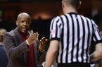 Arkansas head coach Mike Anderson talks with an official in the first half of an NCAA college basketball game against Vanderbilt on Saturday, Feb. 8, 2014, in Nashville, Tenn. (AP Photo/Mark Zaleski)