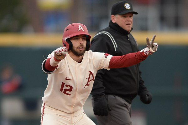 Arkansas catcher Casey Opitz signals to the Razorback dugout after hitting an RBI double Stony Brook Saturday, March 2, 2019, during the inning at Baum-Walker Stadium in Fayetteville.