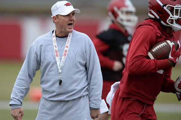 Arkansas coach Chad Morris directs his players Friday, March 1, 2019, during practice at the university practice facility in Fayetteville.