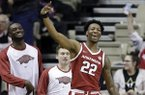 Arkansas forward Gabe Osabuohien celebrates after a score against Vanderbilt during the second half of an NCAA college basketball game Wednesday, March 6, 2019, in Nashville, Tenn. Arkansas won 84-48. (AP Photo/Mark Humphrey)