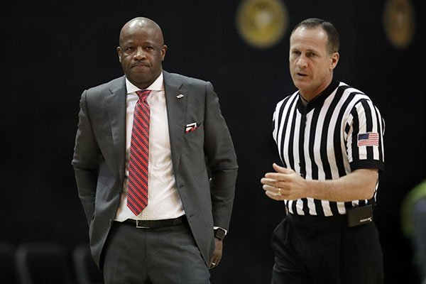 Arkansas head coach Mike Anderson watches the action in the second half of an NCAA college basketball game against Vanderbilt Wednesday, March 6, 2019, in Nashville, Tenn. (AP Photo/Mark Humphrey)