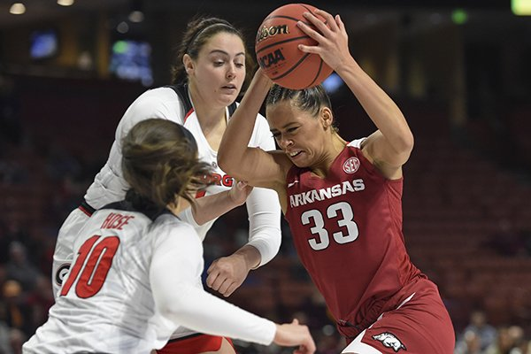 Arkansas's Chelsea Dungee (33) drives against Georgia's Caitlin Hose (10) and Jenna Staiti during the first half of a women's Southeastern Conference NCAA college basketball tournament game Thursday, March 7, 2019, in Greenville, S.C. (AP Photo/Richard Shiro)