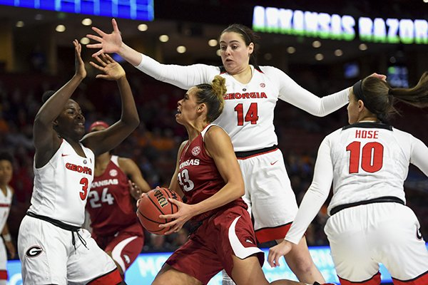 Arkansas's Chelsea Dungee (33) drives against Georgia's Caitlin Hose (10) Jenna Staiti (14) and Stephanie Paul during the first half of a women's Southeastern Conference NCAA college basketball tournament game Thursday, March 7, 2019, in Greenville, S.C. (AP Photo/Richard Shiro)