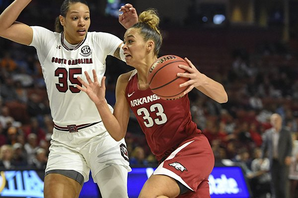 Arkansas' Chelsea Dungee, right, drives while defended by South Carolina's Alexis Jennings during the first half of an NCAA college basketball game in the Southeastern Conference women's tournament Friday, March 8, 2019, in Greenville, S.C. (AP Photo/Richard Shiro)