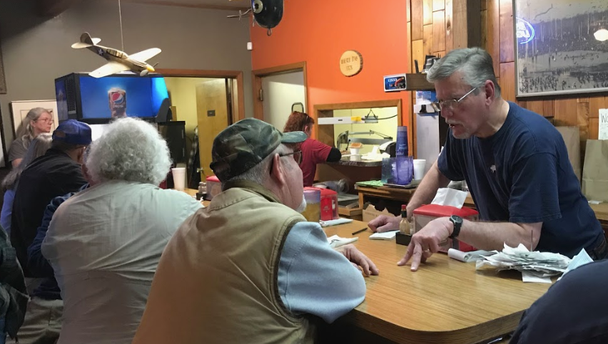 Retired White Pig Inn owner Greg Seaton Sr. visits with customers ahead of the establishment's closure after 99 years on March 8, 2019.