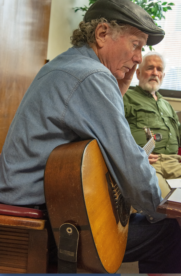Songwriter Wood Newton (left), at work with veteran William Newton. (Arkansas Democrat-Gazette/CARY JENKINS)